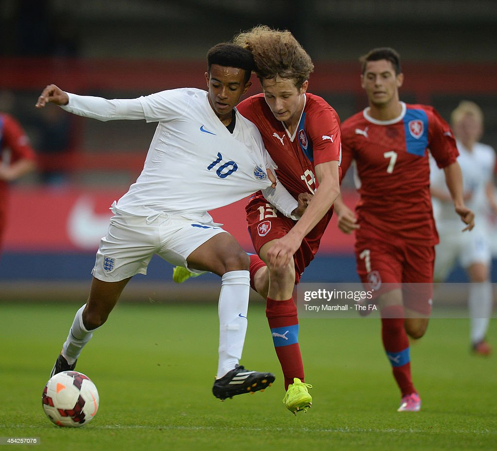 Jacob Maddox of England is tackled by Alex Kral of Czech Republic during the Under 17 International match between England U17 and Czech Republic U17 at Aggborough Stadium on August 27, 2014 in Kidderminster, England.