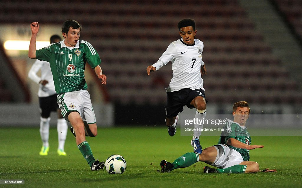 Jacob Maddox of England U16 is tackled by Matthew Henry of Northern Ireland U16 during the Victory Shield match between England U16 and Northern Ireland U16 at Goldsands Stadium on November 8, 2013 in Bournemouth, England.