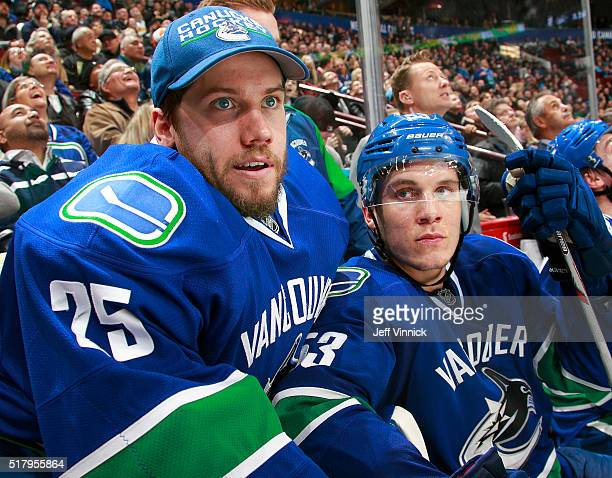 Jacob Markstrom and Bo Horvat of the Vancouver Canucks look on from the bench during their NHL game against the Colorado Avalanche at Rogers Arena...
