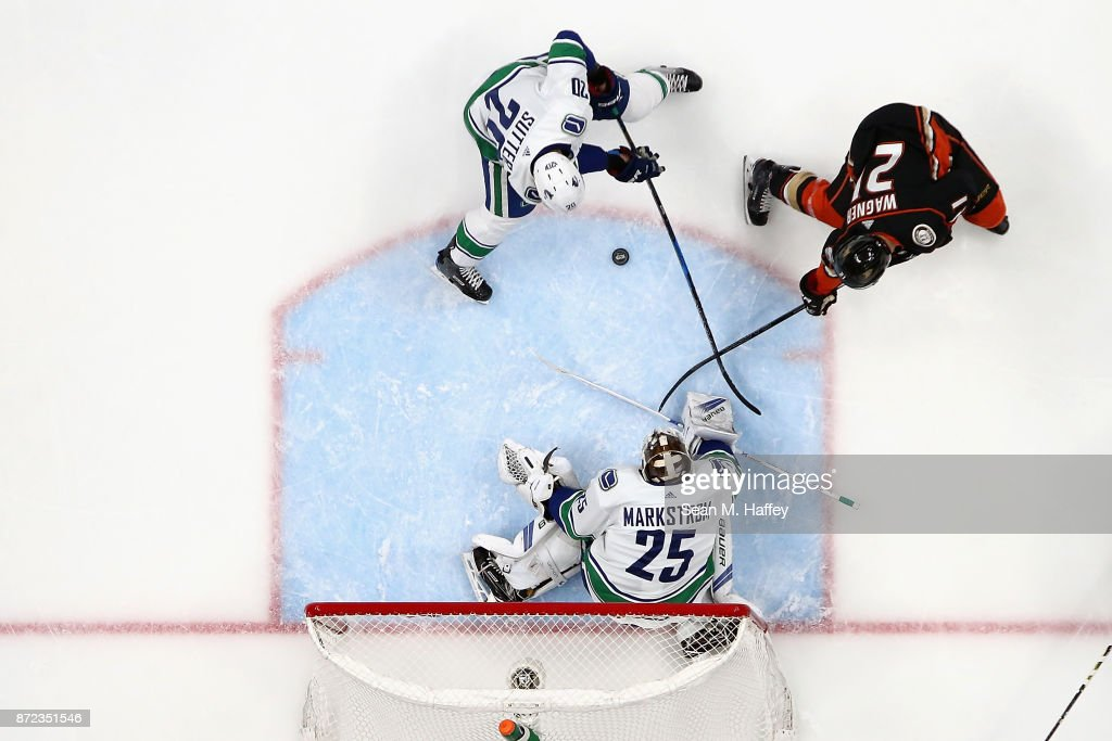 Jacob Markstrom #25 and Brandon Sutter #20 of the Vancouver Canucks defend against Chris Wagner #21 of the Anaheim Ducks during the third period of a game at Honda Center on November 9, 2017 in Anaheim, California.