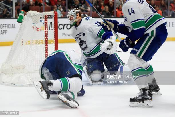 Jacob Markstrom and Erik Gudbranson of the Vancouver Canucks look on after a goal by Hampus Lindholm of the Anaheim Ducks during the first period of...