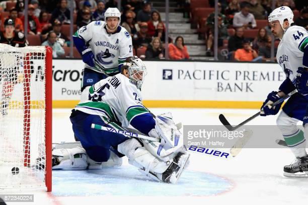Jacob Markstrom Erik Gudbranson and Alexander Edler of the Vancouver Canucks watch the puck after a goal by Jakob Silfverberg of the Anaheim Ducks...