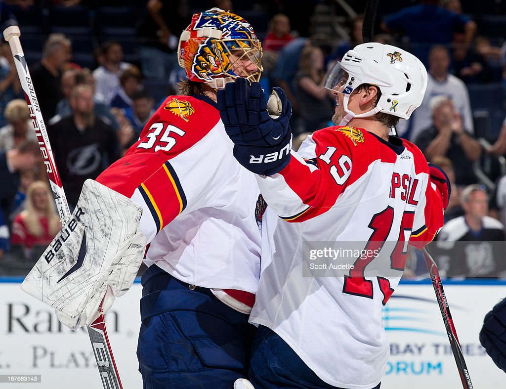 <a gi-track='captionPersonalityLinkClicked' href=/galleries/search?phrase=Jacob+Markstrom&family=editorial&specificpeople=5370948 ng-click='$event.stopPropagation()'>Jacob Markstrom</a> #35 of the Florida Panthers celebrates with teammate <a gi-track='captionPersonalityLinkClicked' href=/galleries/search?phrase=Scottie+Upshall&family=editorial&specificpeople=209198 ng-click='$event.stopPropagation()'>Scottie Upshall</a> #19 after defeating the Tampa Bay Lightning 5-3 at the Tampa Bay Times Forum on April 27, 2013 in Tampa, Florida.