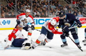 Jacob Markstrom of the Florida Panthers makes a save in front of Filip Kuba Tyson Strachan and Chris Kunitz of the Pittsburgh Penguins on February 22...