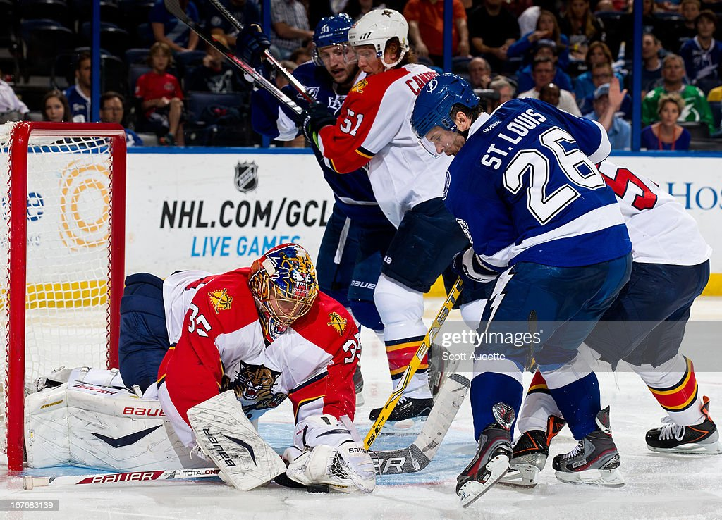 <a gi-track='captionPersonalityLinkClicked' href=/galleries/search?phrase=Jacob+Markstrom&family=editorial&specificpeople=5370948 ng-click='$event.stopPropagation()'>Jacob Markstrom</a> #35 of the Florida Panthers stops a puck shot by <a gi-track='captionPersonalityLinkClicked' href=/galleries/search?phrase=Martin+St.+Louis&family=editorial&specificpeople=202067 ng-click='$event.stopPropagation()'>Martin St. Louis</a> #26 of the Tampa Bay Lightning during the third period of the game at the Tampa Bay Times Forum on April 27, 2013 in Tampa, Florida.