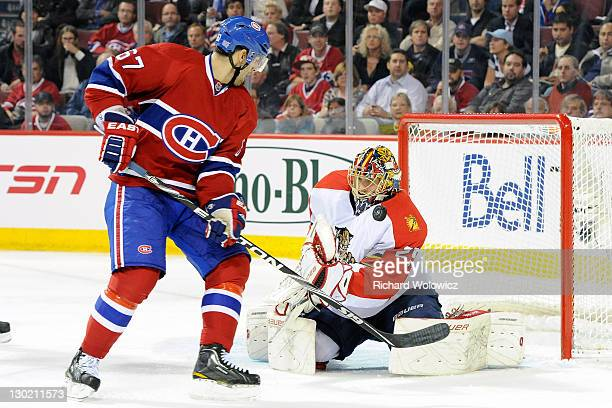 Jacob Markstrom of the Florida Panthers stops the puck in front of Max Pacioretty of the Montreal Canadiens during the NHL game at the Bell Centre on...