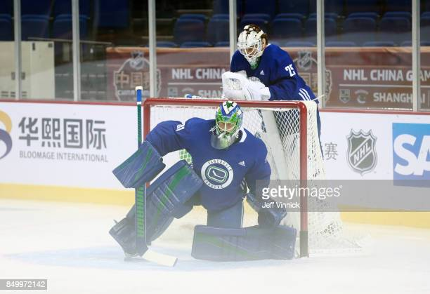 Jacob Markstrom of the Vancouver Canucks looks on as teammate Anders Nilsson kneels in the crease during their practice at MercedesBenz Arena...