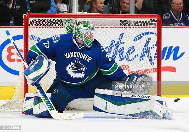 Jacob Markstrom of the Vancouver Canucks makes a pad save during their NHL game against the Edmonton Oilers at Rogers Arena April 9 2016 in Vancouver...