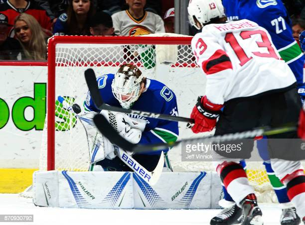 Jacob Markstrom of the Vancouver Canucks makes a save off the shot of Nico Hischier of the New Jersey Devils during their NHL game at Rogers Arena...