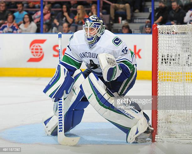 Jacob Markstrom of the Vancouver Canucks prepares to make a save during a preseason game against the Edmonton Oilers on October 1 2015 at Rexall...