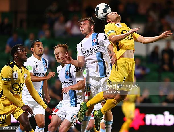 Jacob Melling of Melbourne and Chris Harold of the Glory contest a header during the FFA Cup Semi Final match between Perth Glory and Melbourne City...