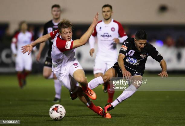 Jacob Melling of the Wanderers competes for the ball against Giorgio Speranza of Blacktown City during the FFA Cup Quarterfinal match between...