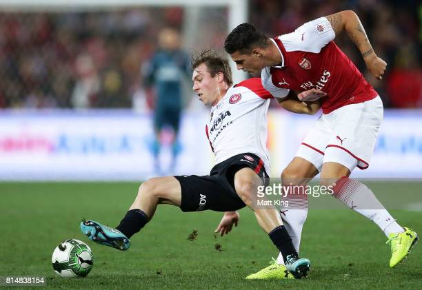 Jacob Melling of the Wanderers is challenged by Granit Xhaka of Arsenal during the match between the Western Sydney Wanderers and Arsenal FC at ANZ...