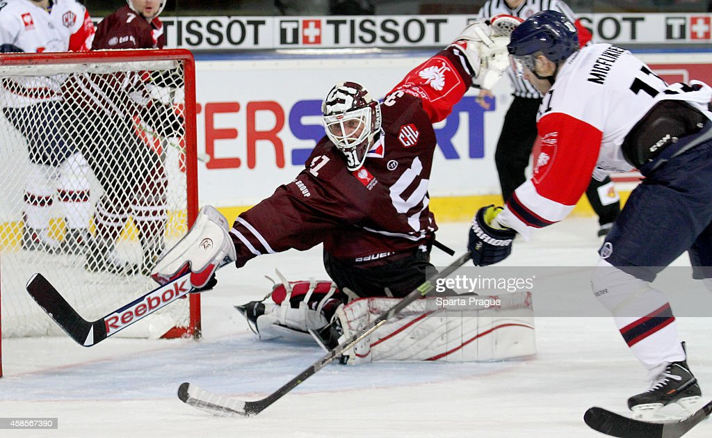Jacob Micflikier #11 of Linkoping HC scores a goal in <a gi-track='captionPersonalityLinkClicked' href=/galleries/search?phrase=Rastislav+Stana&family=editorial&specificpeople=215502 ng-click='$event.stopPropagation()'>Rastislav Stana</a> #31 of Sparta Prague net during the Champions Hockey League round of 16 first leg game between Sparta Prague and Linkoping HC at Tippsport Arena on November 4, 2014 in Prague, Czech Republic.