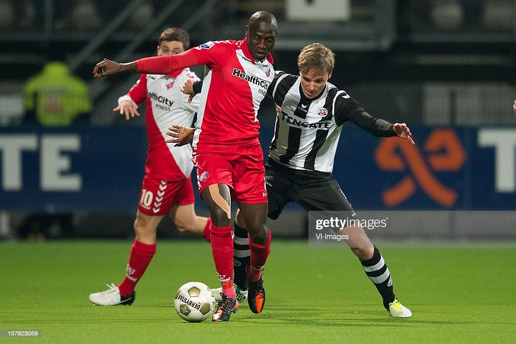 Jacob Mulenga of FC Utrecht, Ben Rienstra of Heracles Almelo during the Dutch Eredivisie match between Heracles Almelo and FC Utrecht at the Polman Stadium on December 7, 2012 in Almelo, The Netherlands.