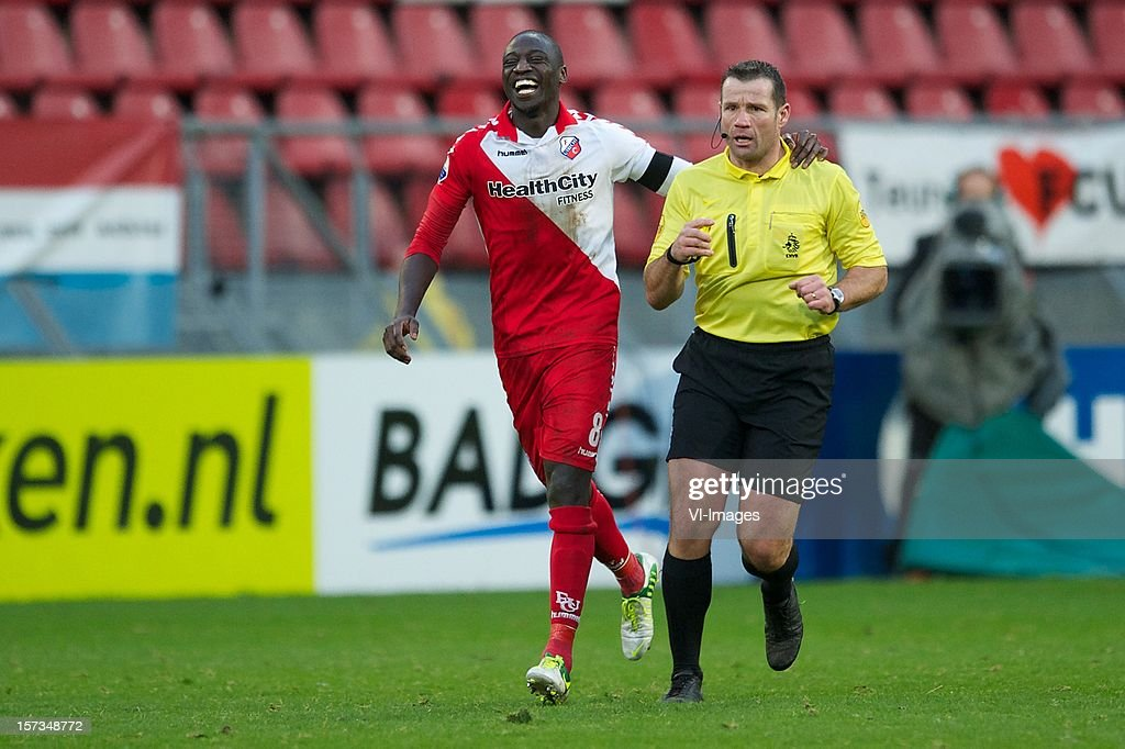 Jacob Mulenga of FC Utrecht, referee Pieter Vink during the Dutch Eredivisie match between FC Utrecht and AZ Alkmaar at the Galgenwaard Stadium on December 02, 2012 in Utrecht, The Netherlands.