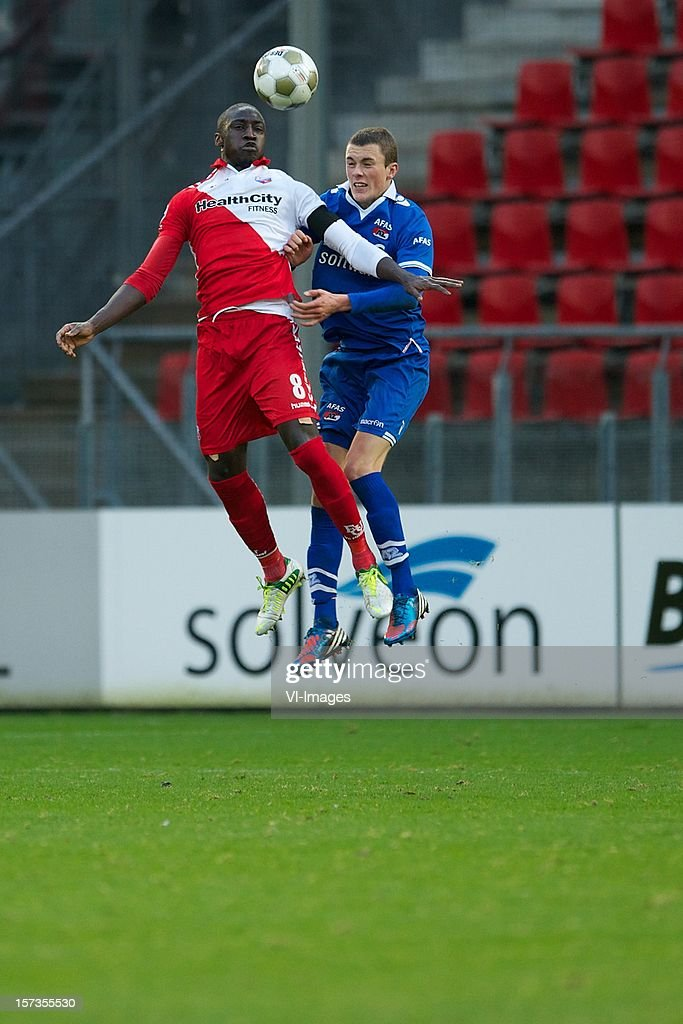Jacob Mulenga of FC Utrecht, Thomas Lam of AZ during the Dutch Eredivisie match between FC Utrecht and AZ Alkmaar at the Galgenwaard Stadium on December 02, 2012 in Utrecht, The Netherlands.
