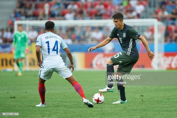 Jacob Murphy of England and MarcOliver Kempf of Germany during the UEFA European Under21 Championship Semi Final match between England and Germany at...
