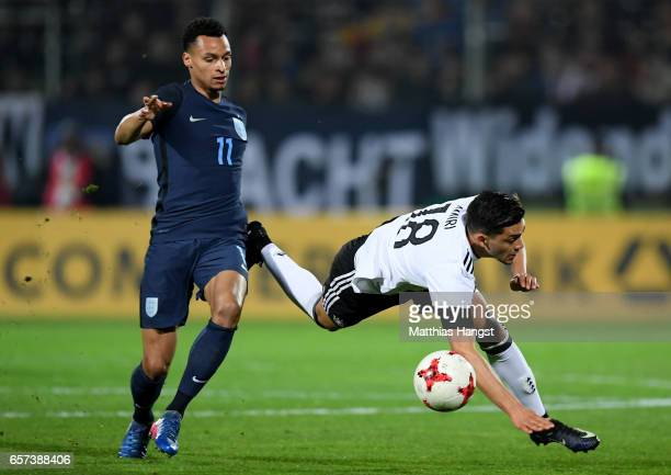 Jacob Murphy of England challenges Nadiem Amiri of Germany during the U21 international friendly match between Germany and England at BRITAArena on...