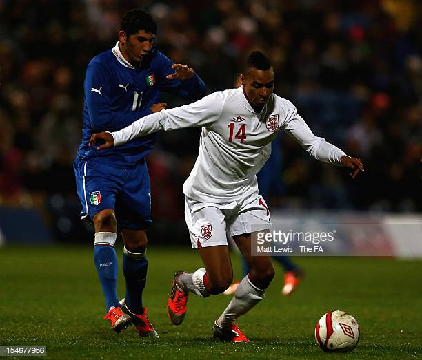 Jacob Murphy of England holds off Luca Crecco of Italy during the International Friendly match between England U18 and Italy U18 at the One Call...