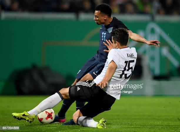 Jacob Murphy of England is challenged by Marc Oliver Kempf of Germany during the U21 international friendly match between Germany and England at...