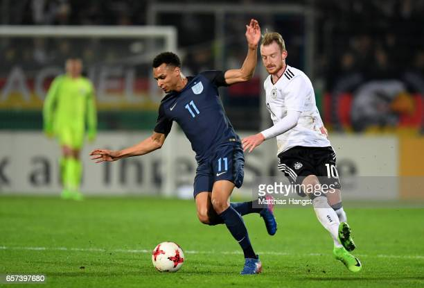 Jacob Murphy of England is challenged by Maximilian Arnold of Germany during the U21 international friendly match between Germany and England at...