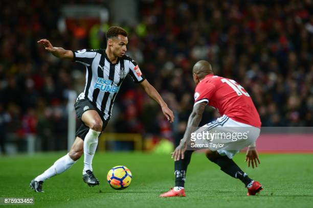 Jacob Murphy of Newcastle United controls the ball whilst Ashley Young of Manchester United looks to challenge during the Premier League match...