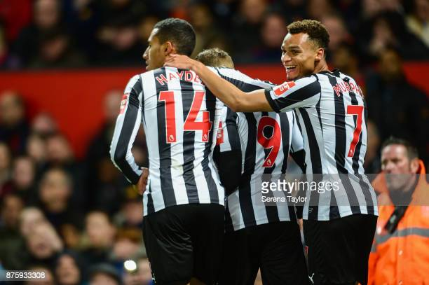 Jacob Murphy of Newcastle United smiles after Dwight Gayle scores the opening goal during the Premier League match between Manchester United and...