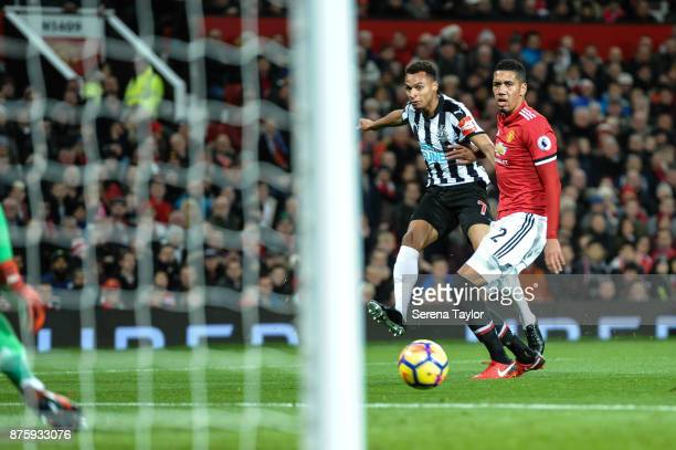 Jacob Murphy of Newcastle United strikes the ball past Victor Lindelof of Manchester United during the Premier League match between Manchester United...