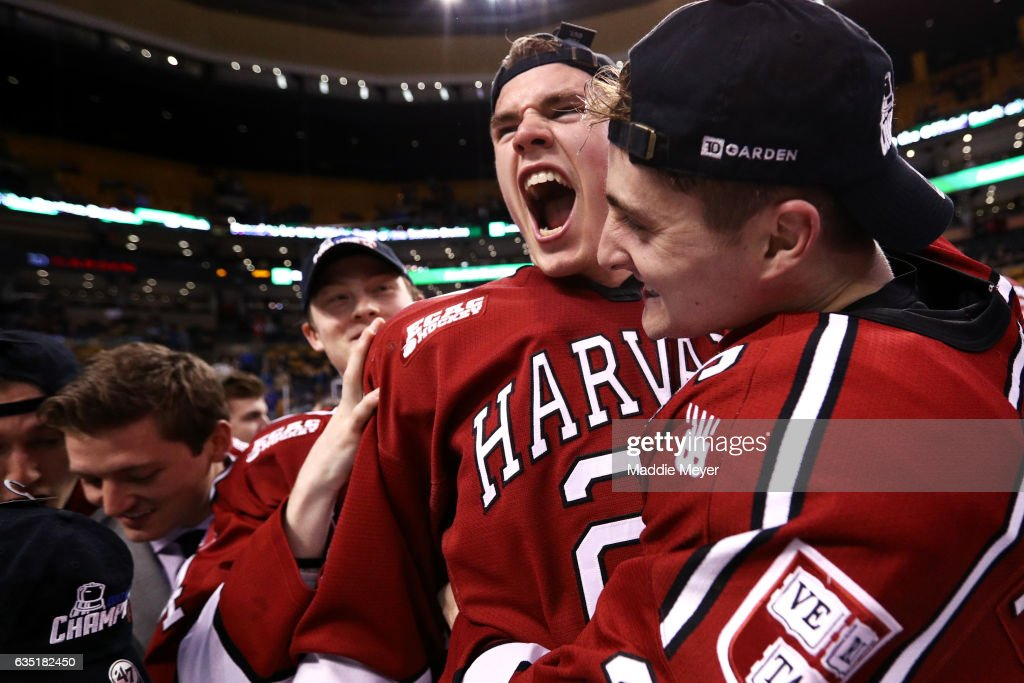 Jacob Olson #26 of the Harvard Crimson and Devin Tringale #22 celebrate after defeating Boston University Terriers 6-3 in the 2017 Beanpot Tournament Championship at TD Garden on February 13, 2017 in Boston, Massachusetts.