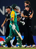 Jacob Oram of New Zealand celebrates with team mate Tim Southee after taking the wicket of Robin Peterson of South Africa during the 2011 ICC World...