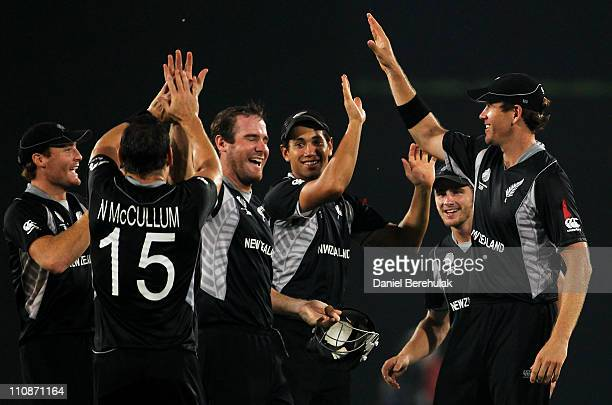 Jacob Oram of New Zealand celebrates with team mates after taking the catch to dismiss Dale Steyn of South Africa off the bowling of Nathan McCullum...