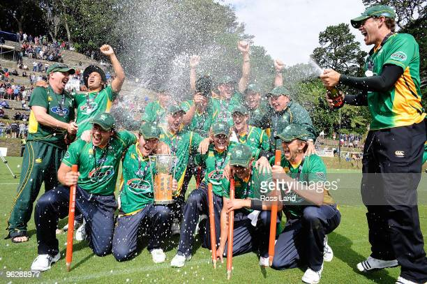 Jacob Oram sprays his Central Stag team mates with Champagne after they won the HRV Twenty20 cricket final over the Auckland Aces at Pukekura Park on...