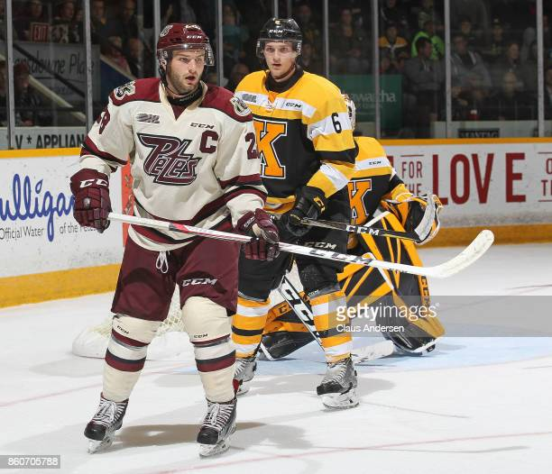 Jacob Paquette of the Kingston Frontenacs watches Logan DeNoble of the Peterborough Petes in an OHL game at the Peterborough Memorial Centre on...