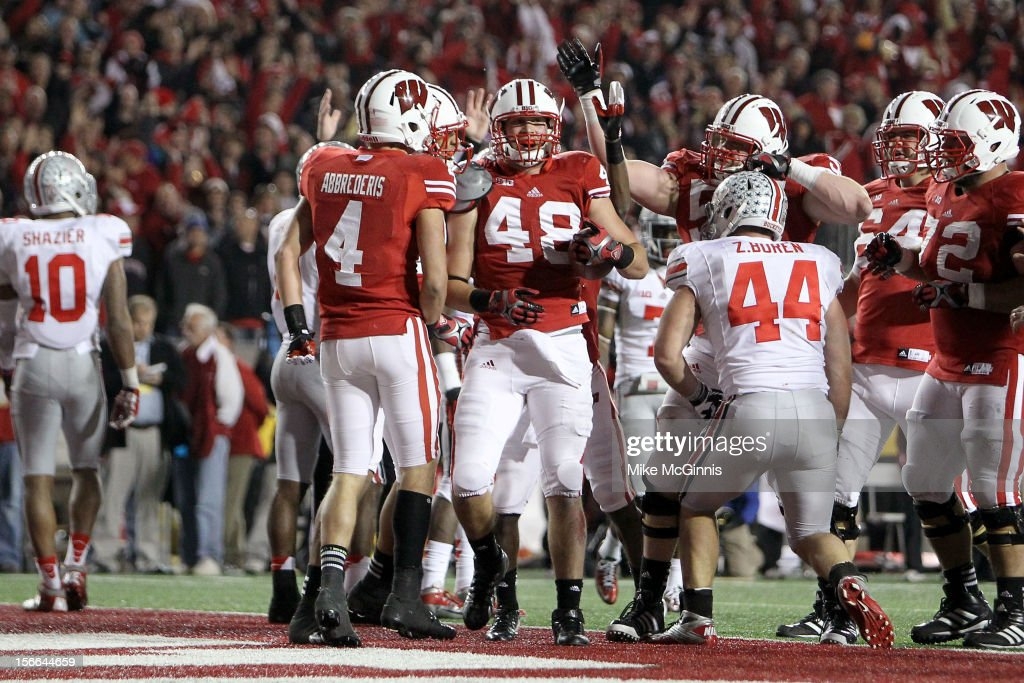 Jacob Pedersen #48 of the Wisconsin Badgers celebrates after scoring a touchdown in the 4th quarter against the Ohio State Buckeyes at Camp Randall Stadium on November 17, 2012 in Madison, Wisconsin.