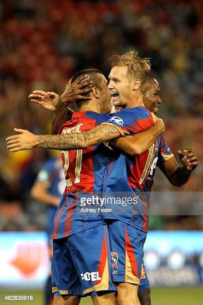 Jacob Pepper of the Jets celebrates a goal with team mates during the round 16 ALeague match between the Newcastle Jets and Brisbane Roar at Hunter...