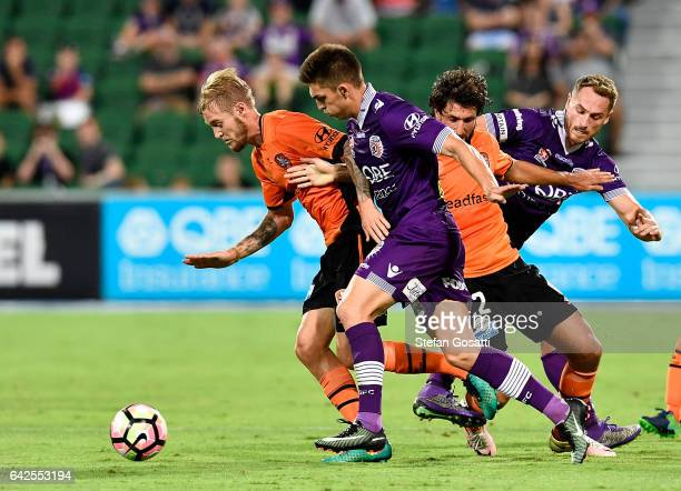 Jacob Pepper of the Roar and Brandon Wilson of the Glory contest the ball during the round 20 ALeague match between Perth Glory and Brisbane Roar at...