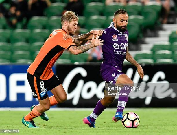 Jacob Pepper of the Roar and Diego Castro of the Glory contests the ball during the round 20 ALeague match between Perth Glory and Brisbane Roar at...