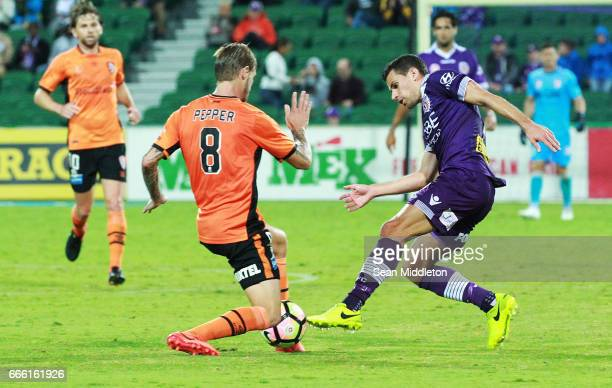 Jacob Pepper of the Roar and Joel Chianese of the Glory during the round 26 ALeague match between the Perth Glory and Brisbane Roar at nib Stadium on...