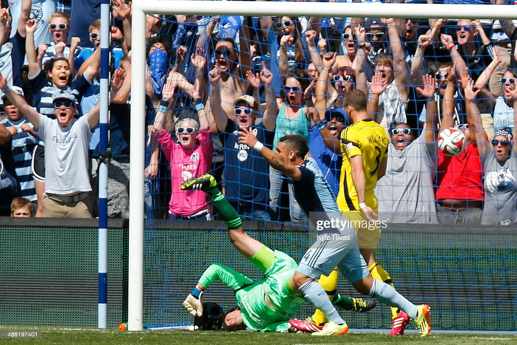Jacob Peterson #37 of Sporting KC scores a goal past Steve Clark #1 of Columbus Crew early in the first half at Sporting Park May 4, 2014 in Kansas City, Kansas.