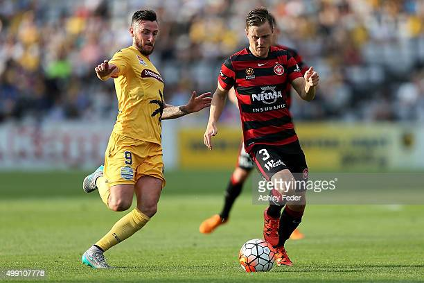 Jacob Poscoliero of the Mariners contests the ball against Scott Jamieson of the Wanderers the during the round eight ALeague match between the...