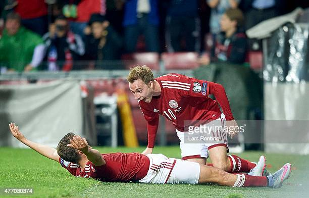 Jacob Poulsen of Denmark celebrates with team mate Christian Eriksen after scoring their second goal during the UEFA EURO 2016 Qualifier match...