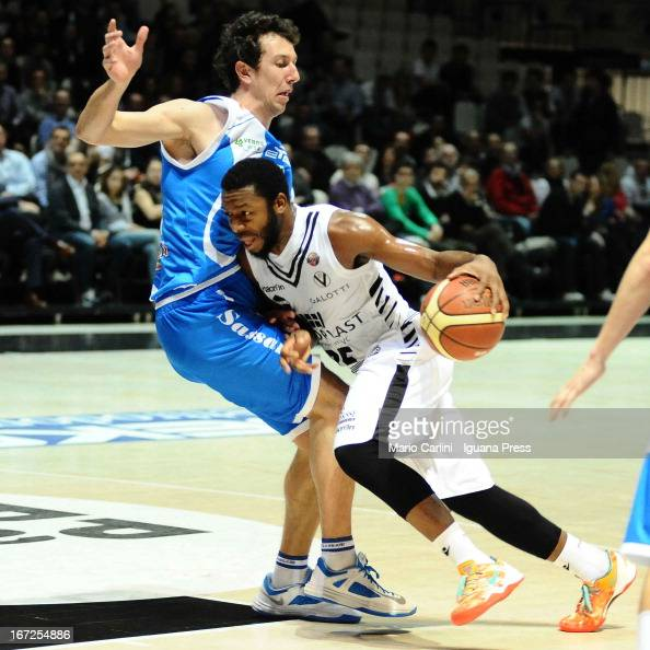 Jacob Pullen of Oknoplast competes with Giacomo Devecchi of Banco di Sardegna during the LegaBasket Serie A match between Oknoplast Bologna and Banco...