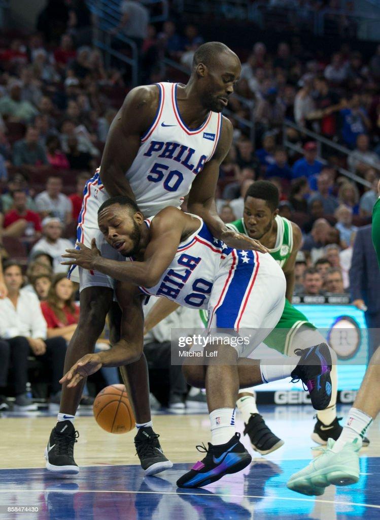 Jacob Pullen #00 of the Philadelphia 76ers dribbles into Emeka Okafor #50 in the fourth quarter of the preseason game against the Boston Celtics at the Wells Fargo Center on October 6, 2017 in Philadelphia, Pennsylvania. The Celtics defeated the 76ers 110-102.