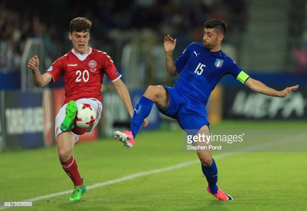 Jacob Rasmussen of Denmark and Marco Benassi of Italy compete for the ball during the UEFA European Under21 Championship Group C match between...