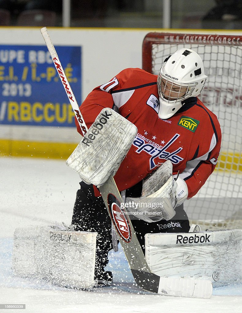Jacob Riley #30 of the Summerside Western Capitals makes a save during the game against the Weeks Crushers on November 25, 2012 at the Consolidated Credit Union Place in Summerside, Prince Edward Island, Canada.
