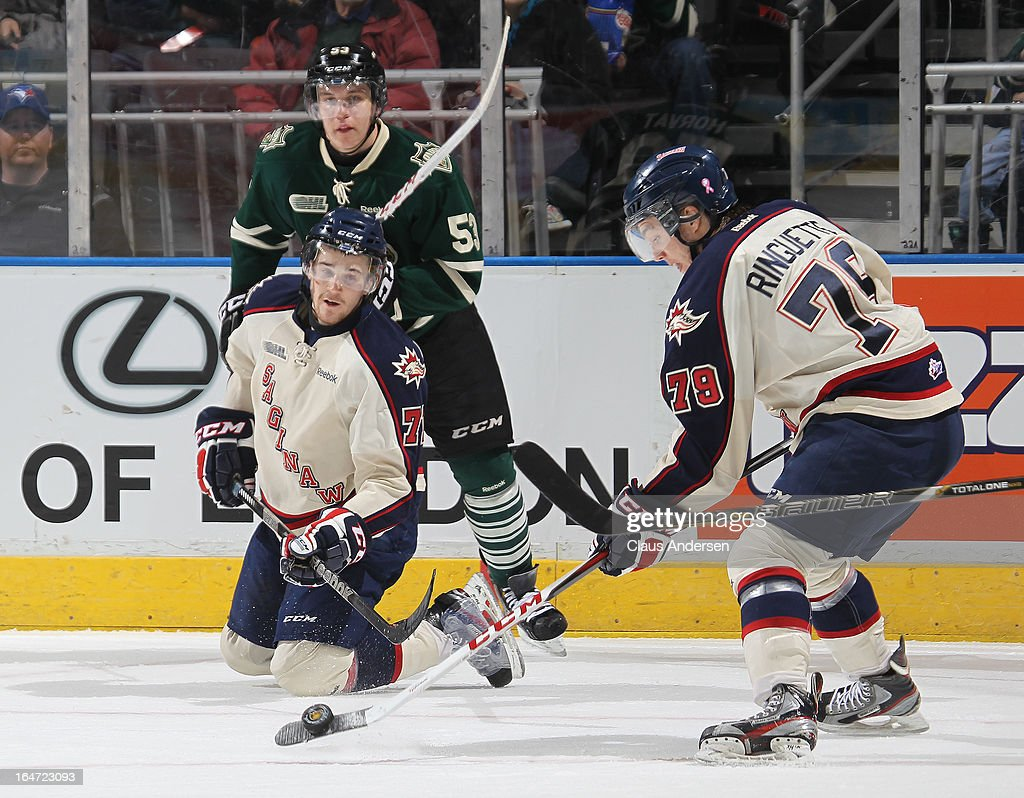 Jacob Ringuette #79 of the Saginaw Spirit clears a puck in a first round playoff game against the London Knights on March 24, 2013 at the Budweiser Gardens in London, Ontario, Canada. The Knights defeated the Spirit 3-2 in double overtime to take a 2-0 series lead.