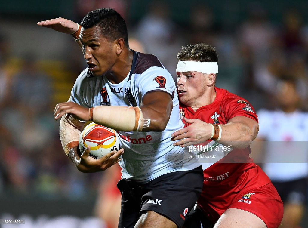 Jacob Saifiti of Fiji is tackled by Morgan Knowles of Wales during the 2017 Rugby League World Cup match between Fiji and Wales at 1300SMILES Stadium on November 5, 2017 in Townsville, Australia.