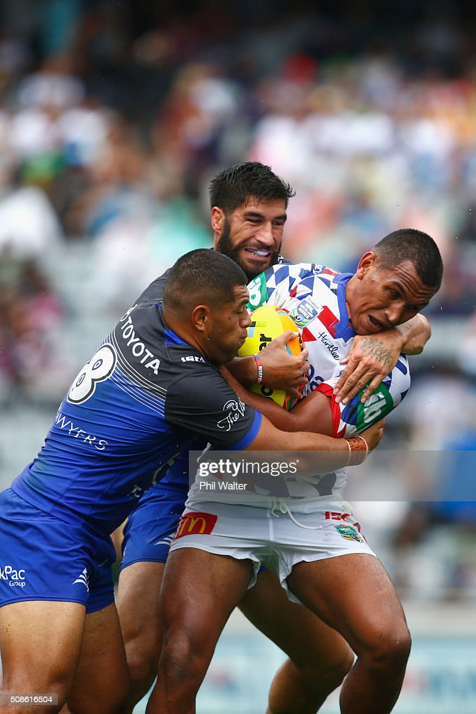 Jacob Saifiti of Newcastle is tackled during the 2016 Auckland Nines match between the Cowboys and the Newcastle Knights at Eden Park on February 6, 2016 in Auckland, New Zealand.