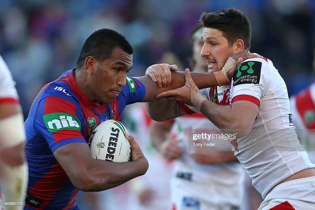 Jacob Saifiti of the Knights is tackled by <a gi-track='captionPersonalityLinkClicked' href=/galleries/search?phrase=Gareth+Widdop&family=editorial&specificpeople=6349002 ng-click='$event.stopPropagation()'>Gareth Widdop</a> of the Dragons during the round 16 NRL match between the Newcastle Knights and the St George Illawarra Dragons at Hunter Stadium on June 25, 2016 in Newcastle, Australia.